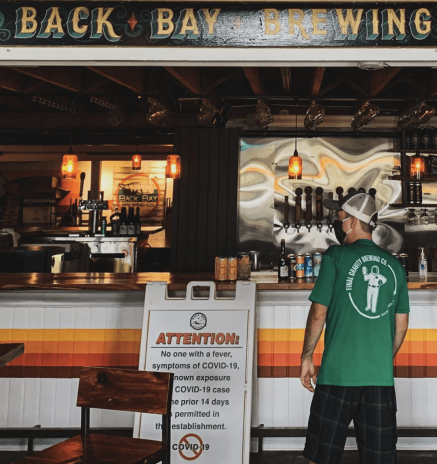 man in front of bar at Back Bay